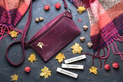 Fall concept. Flat lay, top view. Autumn frame with accessories, yellow leaves and wooden calendar stock photos