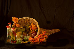 Fall Cornucopia with Seasonings. And Cinamon Sticks isolated on a black background Stock Photos