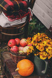 Fall at country house. Seasonal decorations with pumpkins, fresh apples and flowers. Autumn harvest Stock Photo