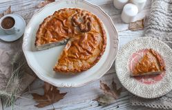 Fall cozy day with pie and coffee. Fall cozy day with cup of coffee, dried leaves stock image