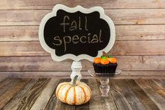 Fall cupcake with gourd and chalkboard sign Royalty Free Stock Image