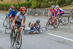 Fall of cyclist on the road Royalty Free Stock Image