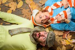 Fall date pleasant cozy atmosphere. Autumn date concept. Man bearded cheerful face and lady lay on wooden background. With leaves top view. Couple in love wear stock image