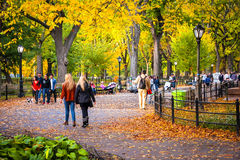 Fall Day Central Park. NEW YORK-OCTOBER 29: New Yorkers and tourists enjoy a beautiful Fall day on October 29 2015 on the Mall in Central Park Royalty Free Stock Photos