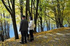 Fall day. Seniors enjoy a wonderful sunny fall day at Rursee in Eifel, germany royalty free stock photos