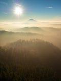 Fall daybreak. Misty awakening in beautiful hills. Peaks of hills Royalty Free Stock Photos
