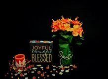 Fall Decor Scene- Flowers, Candle, Wood Block Royalty Free Stock Images