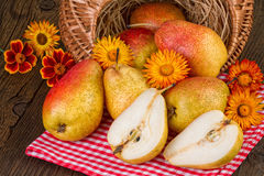 Fall decoration with yellow red pears on wooden table. Stock Photo
