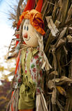 Fall decorations with scarecrow and hay stack. Stock Images