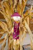 Fall decorations with scarecrow and hay stack. Stock Image