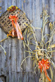 Fall decorations on the side of a wooden barn. Stock Images