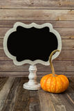 Fall decorative gourd and blank sign Stock Photo