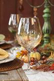 Fall dining table with focus on wine glass Stock Photo