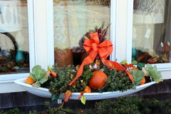 Fall display. Fall floral display in window box shaped like a boat Stock Photography