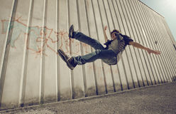 Fall down. Young man falling from a building Stock Image
