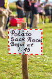 Fall Farm Fair. Handmade race sign at an old time fall farm fair with the competitors in the background Royalty Free Stock Image