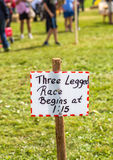 Fall Farm Fair. Handmade race sign at an old time fall farm fair with the competitors in the background Royalty Free Stock Photo