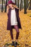 Fall fashion concept, Beautiful elegant woman in park Stock Photos