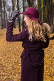 Fall fashion concept, Beautiful elegant woman in park Stock Images