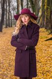 Fall fashion concept, Beautiful elegant woman in park Stock Image