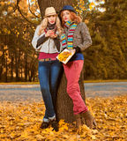 Fall Fashion. Friends Woman walk in Autumn park Royalty Free Stock Photography