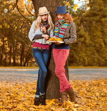 Fall Fashion. Friends Woman walk in Autumn park Stock Photo