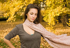 Fall fashion girl with flowing scarf. Stock Images