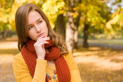 Fall fashion girl pondering. Royalty Free Stock Photo
