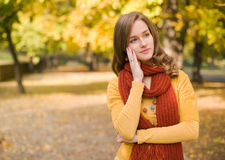 Fall fashion girl pondering. Stock Image