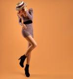 Fall Fashion. Woman Autumn Dress. Long Legs. Retro. Fall Fashion. Model Woman in Autumn fashion Outfit. Stylish Dress Trendy Hat Fashion autumn shoes. Glamour Royalty Free Stock Images