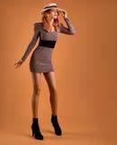 Fall Fashion. Woman Autumn Dress. Long Legs. Retro Royalty Free Stock Image