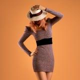 Fall Fashion. Woman Autumn Dress. Long Legs. Retro. Fall Fashion. Model Woman in Autumn Outfit. Stylish Dress, Trendy Hat, Wavy Hairstyle. Fashion autumn Lady Stock Images