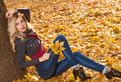 Fall Fashion. Woman in Autumn park,Outdoor.Sadness Stock Photo