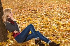 Fall Fashion. Woman in Autumn park,Outdoor.Sadness Stock Images