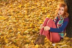 Fall Fashion. Woman in Autumn park,Outdoor.Sadness Royalty Free Stock Photos