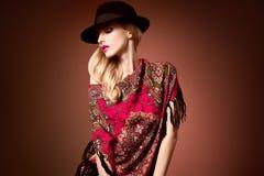 Fall Fashion. Woman in Autumn Shawl. Stylish Hat. Fall Fashion. Model Woman in Autumn Fashion Shawl, Stylish Trendy Hat. Playful Blonde girl with Wavy hair Stock Image