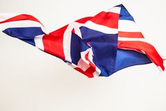 The fall of the flag of Britain. Falling leaf of a great state. Royalty Free Stock Image