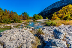 Fall Foliage Along a Gravelly Section of the Frio River of Texas Stock Photo