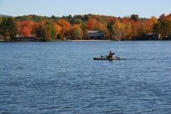 Fall foliage boat stock photo