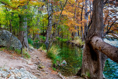Fall Foliage and a Large Boulder near the Frio River. Beautiful Multicolored Fall Foliage Surrounding the Clear Green Waters of the Frio River, Texas as well as Stock Images