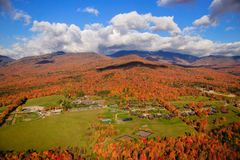Fall foliage on Mt. Mansfield in Stowe, Vermont, USA. Fall foliage landscape with Trapp Family Lodge and Mt. Mansfield in the background, Stowe, Vermont, USA Stock Image