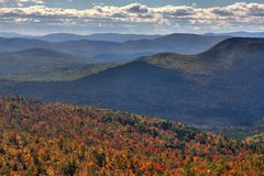 Fall foliage in New England. Change of foliage colors in Fall in New Hampshire. Squam Lake region Stock Photos