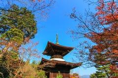 Fall foliage and the pagoda at Jojakko-ji Temple. Jojakko-ji Temple is a  temple on the main Arashiyama tourist route,Kyoto,Japan.Famous for fall foliage Royalty Free Stock Photos