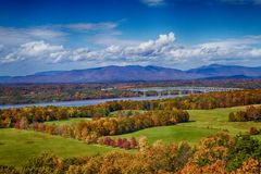 Fall Foliage in Rhinebeck, NY. This is an image of the Rhinebeck-Rhinecliff bridge, the Hudson River, and the mountains/foliage that surrounds it. This image royalty free stock photography