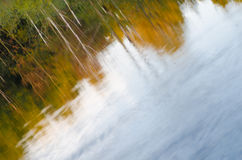 Fall forest reflection in lake Stock Image