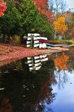 Fall forest reflections with canoes Royalty Free Stock Images