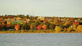 Fall in Fredericton, Canada. University of New Brunswick campus in warm morning sun with rich fall colors, city of Fredericton, New Brunswick Canada Royalty Free Stock Images