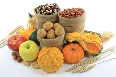 Fall Fruits, Nuts and squashes. Still Picture of pile from Fall Fruits, Nuts and Gourds (squashes) over white background Royalty Free Stock Photo