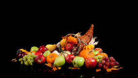 Fall fruits and vegetables in a cornucopia Royalty Free Stock Images