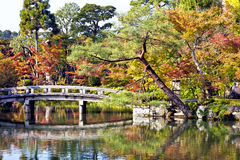Fall garden landscape with bridge and water reflections Stock Image